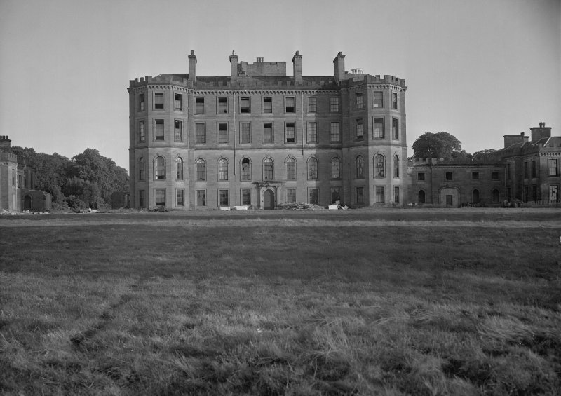 View of North front of central block of Gordon Castle during demolition work