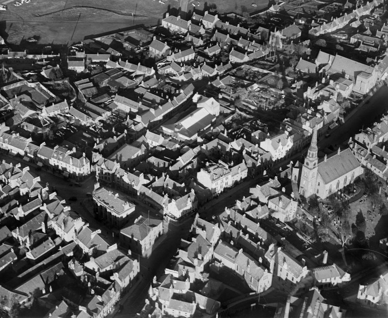 Forfar, general view, showing East High Street with Forfar Parish Church and Town Hall.  Oblique aerial photograph taken facing north-east.