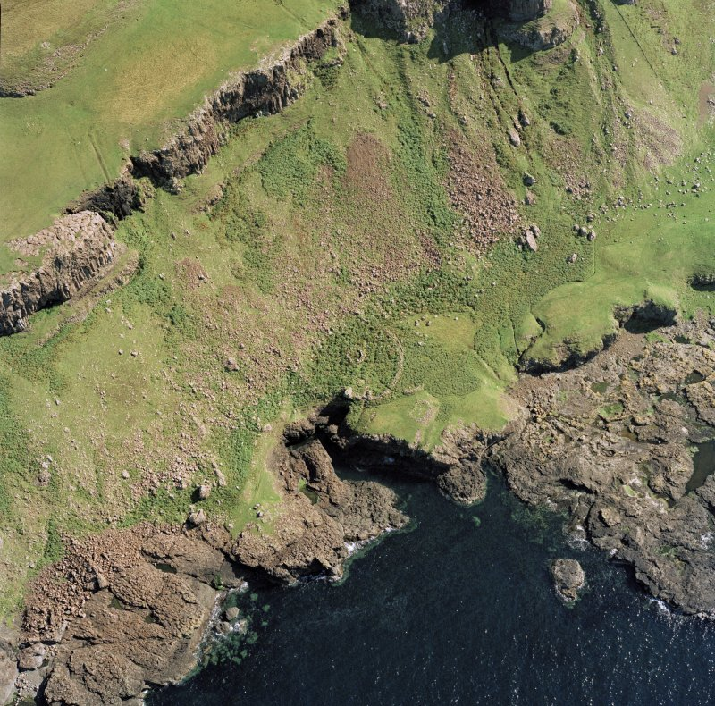 Oblique aerial view of Sgor nam Ban-Naomha, monastic settlement (possible), Canna.