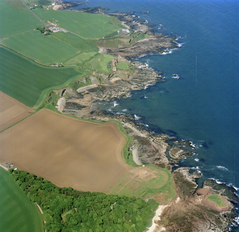 Oblique aerial view centred on the excavation of Auldhame chapel and cemetery and the remains of Tantallon Castle and dovecot with the scientific research establishment, farmsteading and remains of the laird¿s house adjacent, taken from the ESE.
