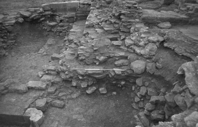 Jedburgh Abbey excavation archive Frames 20: Rubble below scarcement of S wall of Room 11, from E