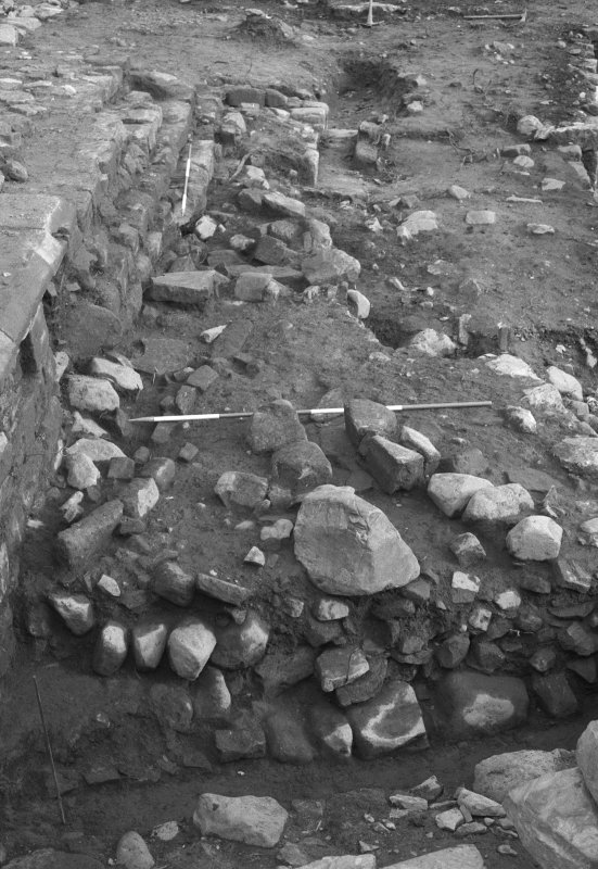 Jedburgh Abbey excavation archive Frame 24: Area 2: Trench G: S of wall 385, below road 403, showing drains 653 on right and 659 on left. From W.