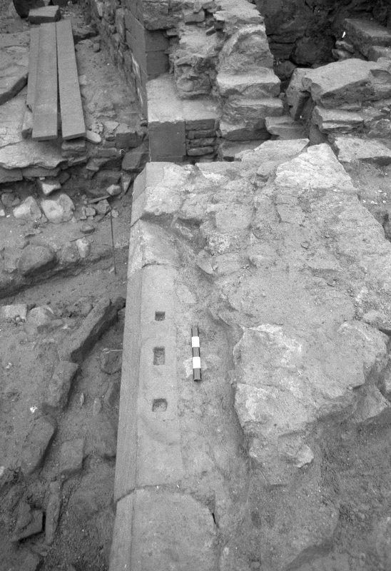 Jedburgh Abbey excavation archive Frame 24: Area 2: Trench G: Sockets cut into chamfer of S face of Wall 385. From E.