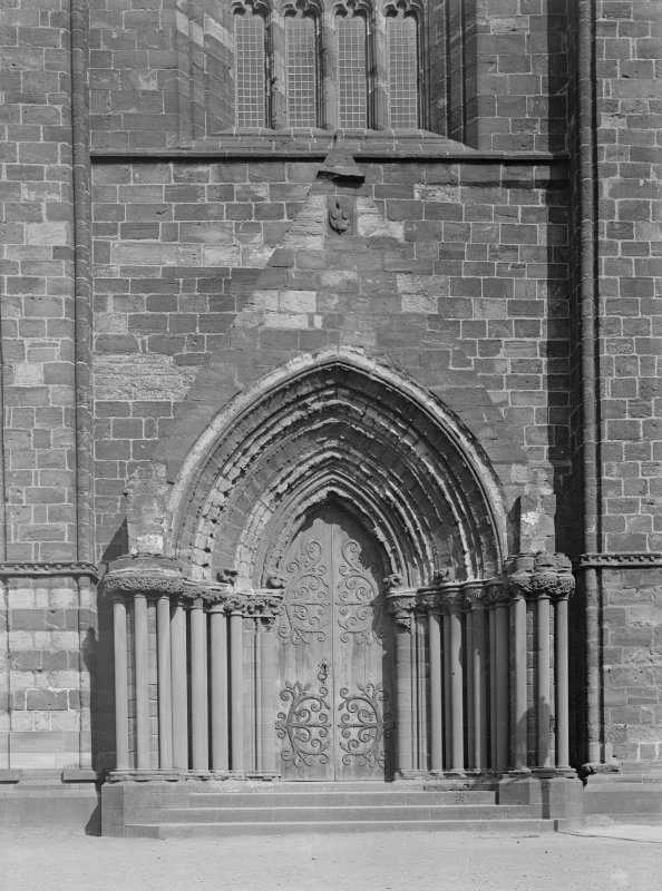 Detail of mid doorway of W front.