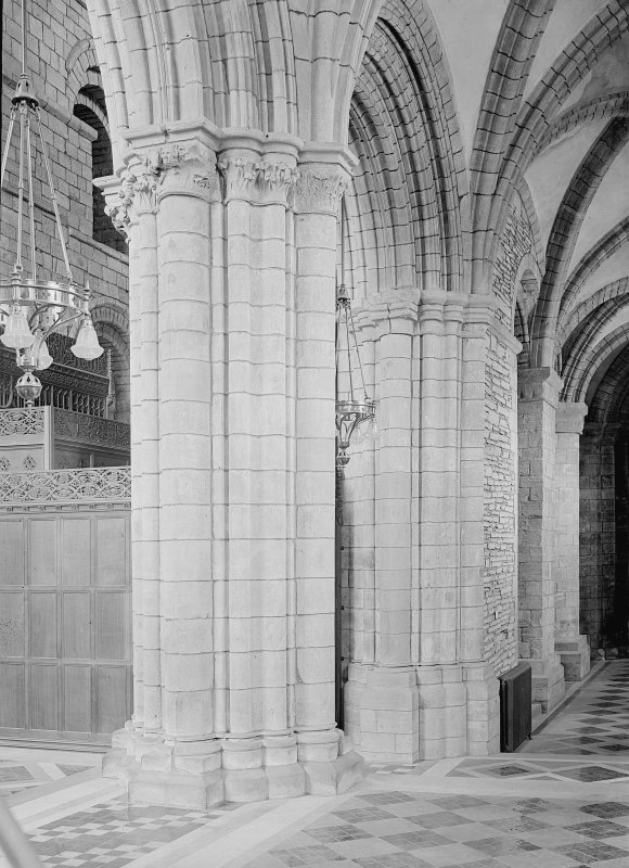 Interior. Choir, view of aisle and capital.