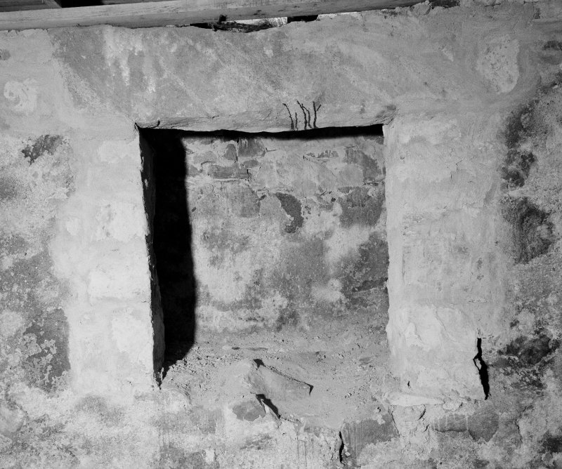 Interior. First floor, kitchen, detail of fireplace.