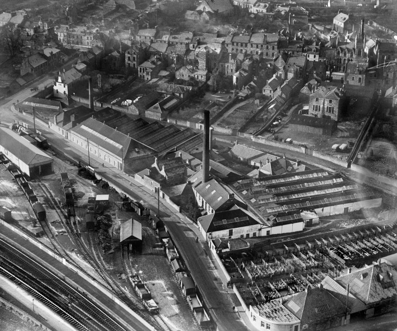 Cupar, general view, showing Edenside Printing Works and Station Road.  Oblique aerial photograph taken facing west.
