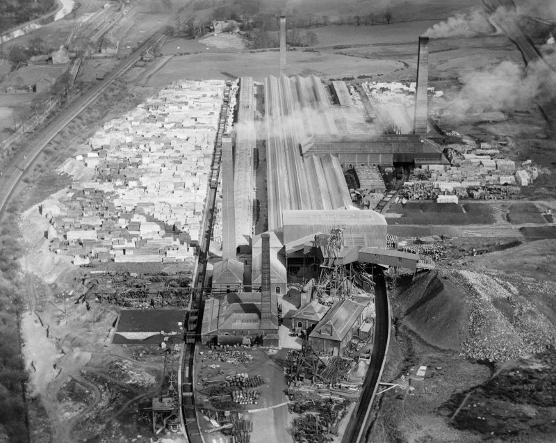 Oblique aerial view of John G Stein and Co. Ltd., Castlecary Brickworks taken facing east.