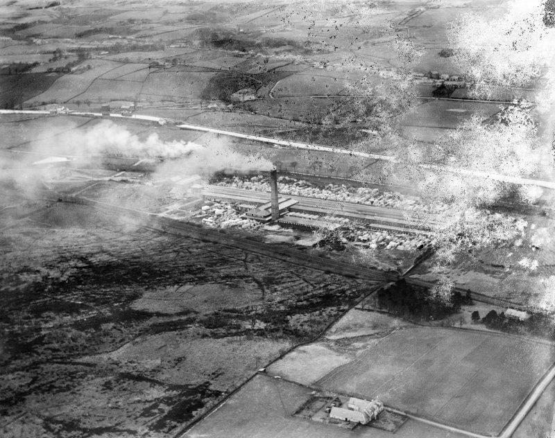 John G Stein and Co. Ltd., Castlecary Brickworks.  Oblique aerial photograph taken facing north-west.  This image has been produced from a damaged negative.