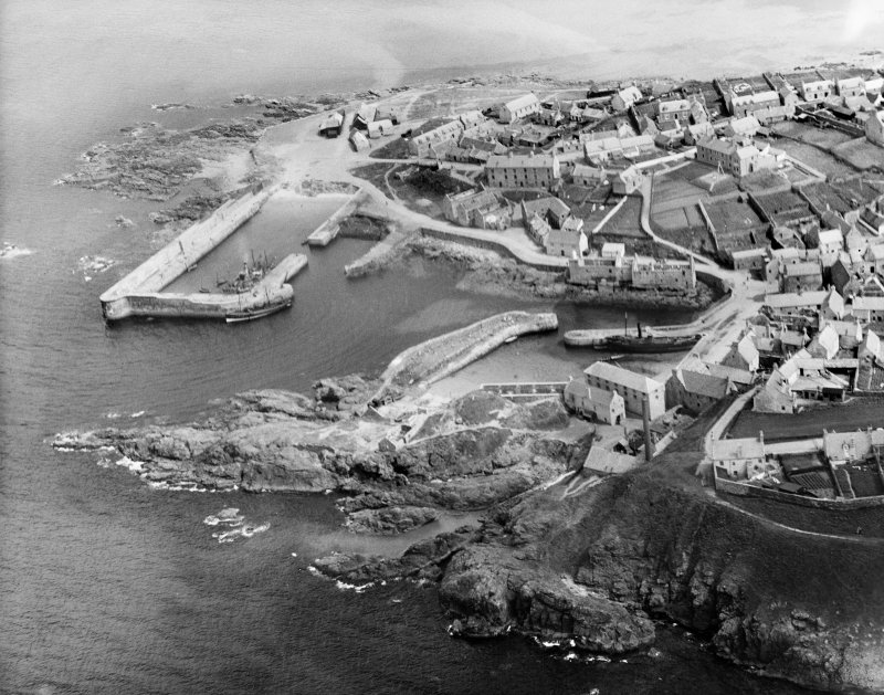 Portsoy, general view, showing Old and New Harbours.  Oblique aerial photograph taken facing east.