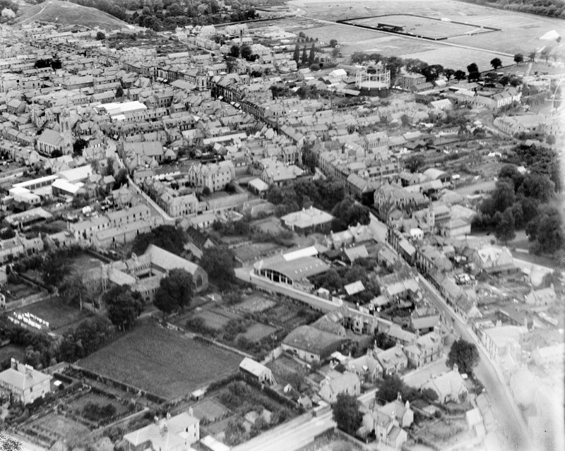 Elgin, general view, showing Greyfriars Convent of Mercy and High Street.  Oblique aerial photograph taken facing west.
