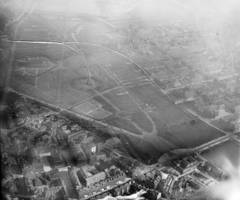 Glasgow, general view, showing Glasgow Green and River Clyde.  Oblique aerial photograph taken facing south.  This image has been produced from a damaged negative.