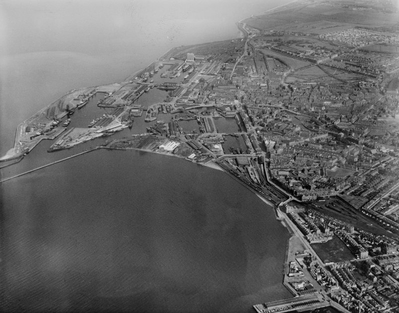Edinburgh, general view, showing Leith Docks and Leith Links.  Oblique aerial photograph taken facing east.