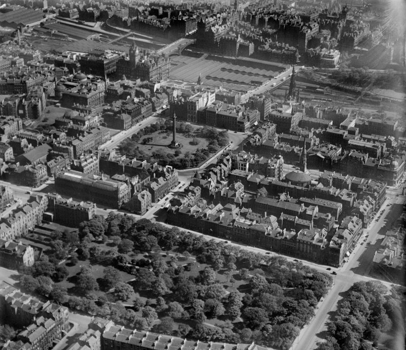 Edinburgh, general view, showing Waverley Station, St Andrew Square and Queen Street Gardens.  Oblique aerial photograph taken facing south-east.