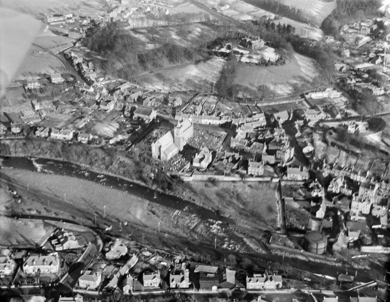 Dunblane, general view, showing Dunblane Cathedral and Holmehill House.  Oblique aerial photograph taken facing north-east.