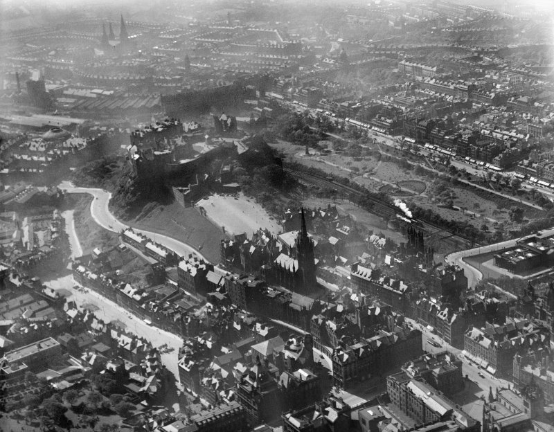 Edinburgh, general view, showing Edinburgh Castle and Princes Street Gardens.  Oblique aerial photograph taken facing north-west.
