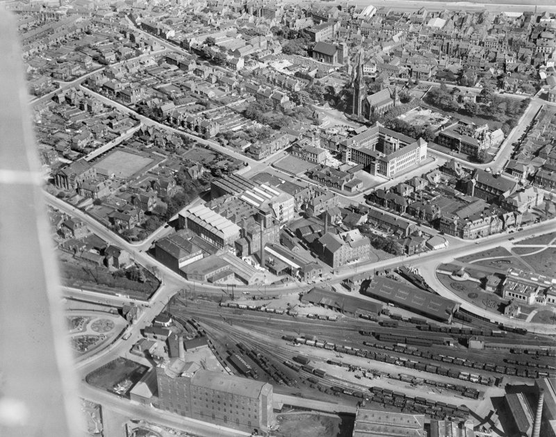 Kirkcaldy, general view, showing National Linoleum Works, Bennochy Road and St Brycedale Church of Scotland.  Oblique aerial photograph taken facing east.
