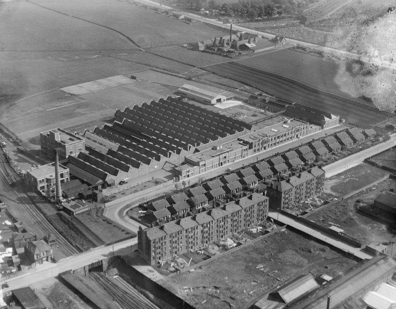 Macfarlane, Lang and Co. Biscuit Factory, Clydeford Drive, Glasgow with the Govancroft Pottery in the background.  Oblique aerial photograph taken facing south.