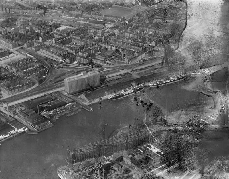 Glasgow, general view, showing Meadowside Granary and West of Scotland Cricket Club.  Oblique aerial photograph taken facing north-east.  This image has been produced from a damaged negative.