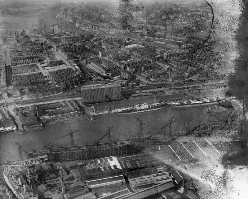 Glasgow, general view, showing Meadowside Granary and Upper Clyde Shipbuilding Yard.  Oblique aerial photograph taken facing north.  This image has been produced from a damaged negative.
