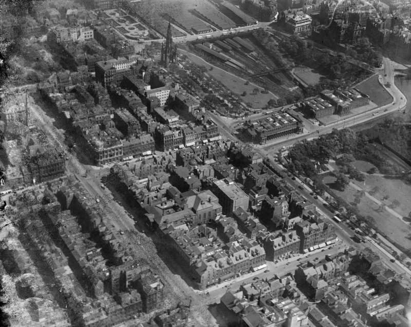 Edinburgh, general view, showing George Street, The Mound and Princes Street Gardens.  Oblique aerial photograph taken facing east.  This image has been produced from a damaged negative.