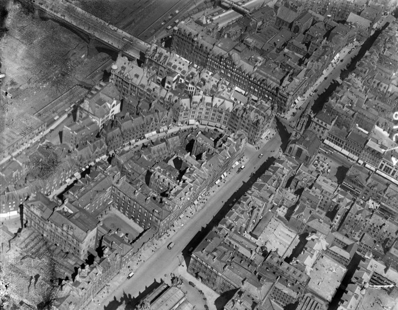 Edinburgh, general view, showing High Street, Cockburn Street and Tron Kirk.  Oblique aerial photograph taken facing north-east.  This image has been produced from a damaged negative.
