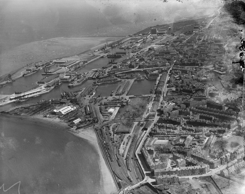 Leith Docks, Edinburgh.  Oblique aerial photograph taken facing east.  This image has been produced from a damaged negative.