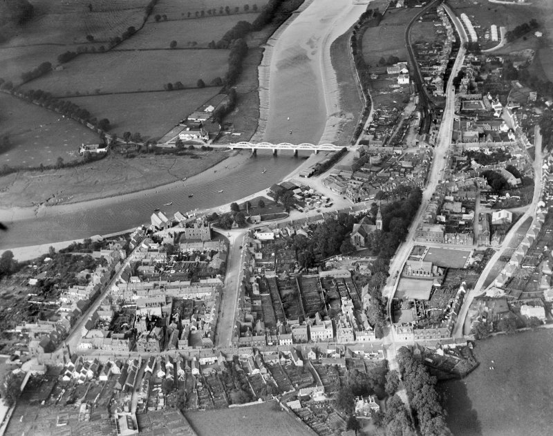 Kirkcudbright, general view, showing Kirkcudbright Bridge, St Mary Street and MacLellan's Castle.  Oblique aerial photograph taken facing north-east.