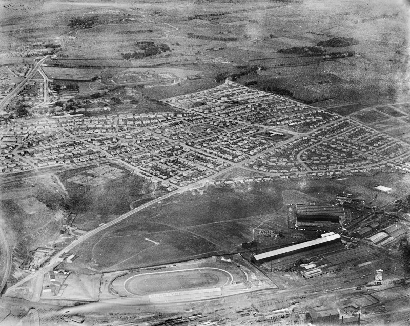 Carntyne Housing Estate and Carntyne Greyhound Racecourse, Glasgow.  Oblique aerial photograph taken facing north-east.