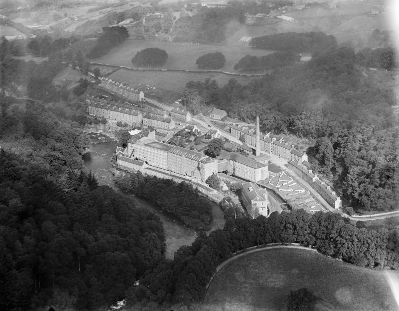 New Lanark, general view, showing Gourock Ropework Co. Ltd. Mills and New Lanark Road.  Oblique aerial photograph taken facing north.