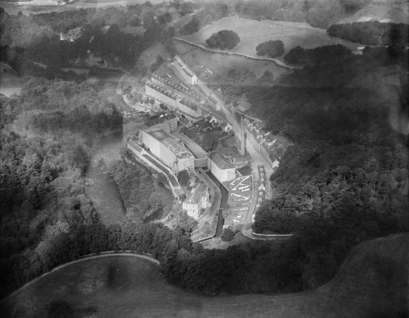 New Lanark, general view, showing Gourock Ropework Co. Ltd. Mills and New Lanark Road.  Oblique aerial photograph taken facing north-east.