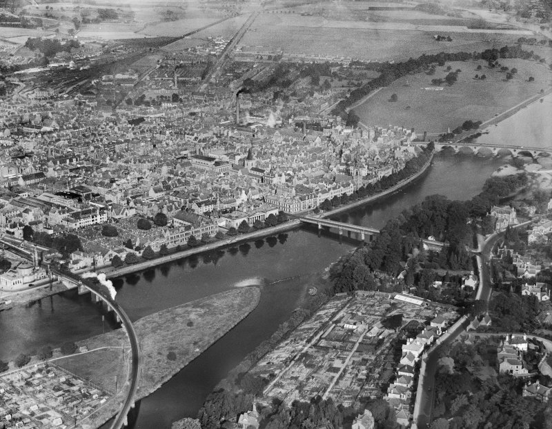 Perth, general view, showing the Bridges and North Inch Golf Course.  Oblique aerial photograph taken facing north.