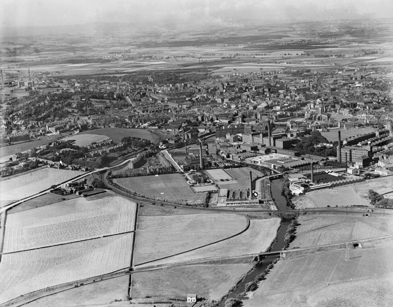 Paisley, general view, showing Clark and Co. Anchor Mills Thread Works and Lonend.  Oblique aerial photograph taken facing west.