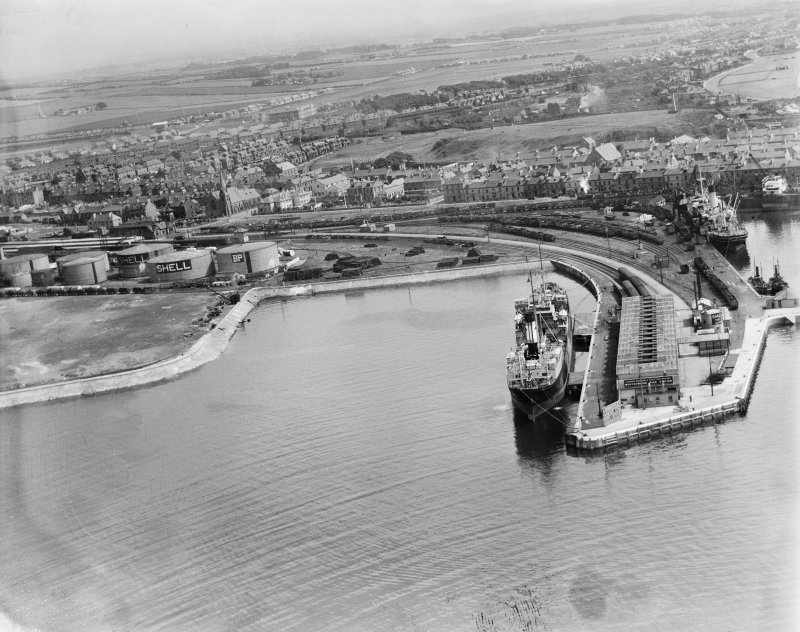 Ardrossan, general view, showing Montgomerie Pier and Ardrossan Refinery.  Oblique aerial photograph taken facing east.