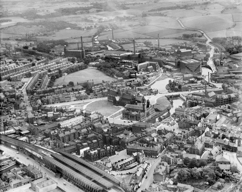 Paisley, general view, showing Paisley Abbey and Clark and Co. Anchor Mills Thread Works.  Oblique aerial photograph taken facing south-east.