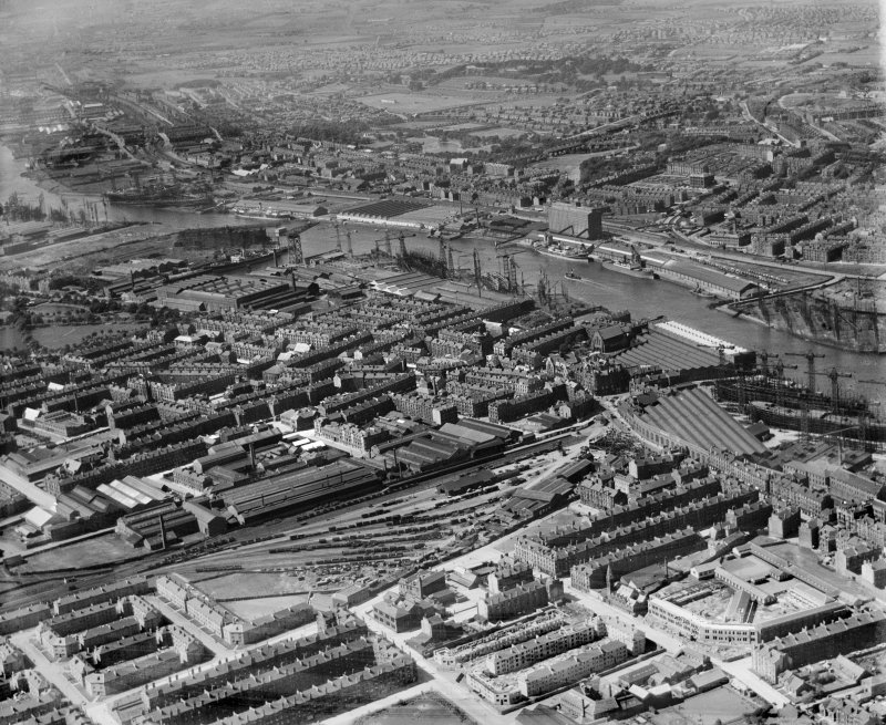 Glasgow, general view, showing Meadowside Granary and Upper Clyde Shipbuilding Yard.  Oblique aerial photograph taken facing north.