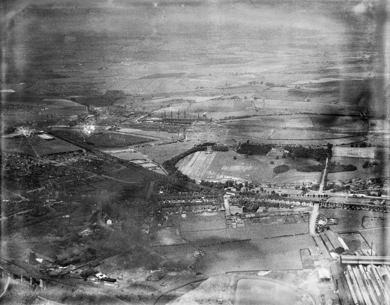 Coatbridge, general view, showing Monkscourt Avenue and Coatdyke Station.  Oblique aerial photograph taken facing north.  This image has been produced from a damaged negative.