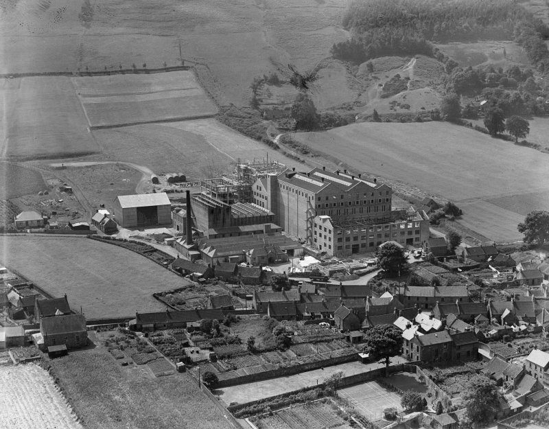 Scottish Co-operative Wholesale Society Ltd. Floorcloth and Linoleum Factory, St John's Works, Falkland, under construction.  Oblique aerial photograph taken facing south.
