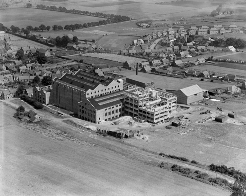 Scottish Co-operative Wholesale Society Ltd. Floorcloth and Linoleum Factory, St John's Works, Falkland, under construction.  Oblique aerial photograph taken facing north-east.