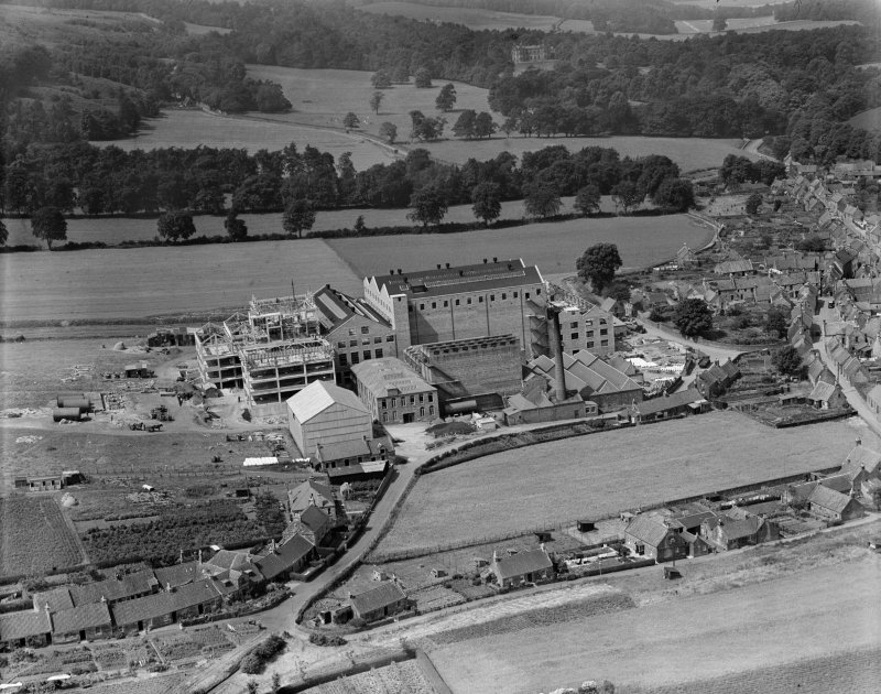 Scottish Co-operative Wholesale Society Ltd. Floorcloth and Linoleum Factory, St John's Works, Falkland, under construction.  Oblique aerial photograph taken facing west.