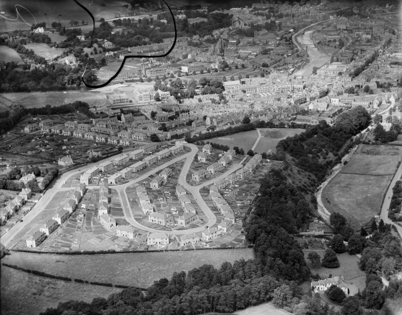 Hawick, general view, showing Moar Park and Upper Common Haugh.  Oblique aerial photograph taken facing north.  This image has been produced from a damaged negative.