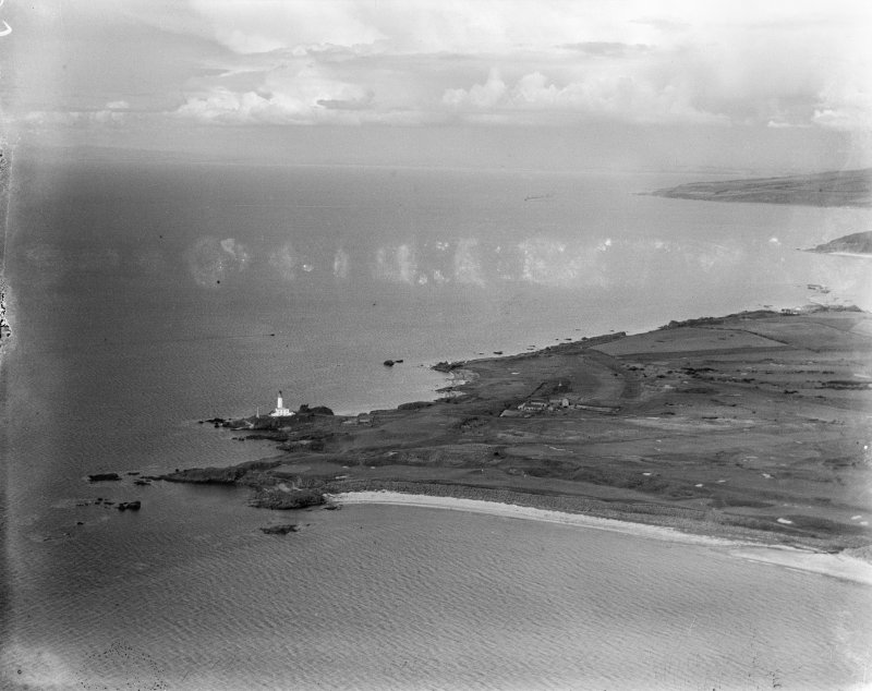 Turnberry Lighthouse and Turnberry Bay.  Oblique aerial photograph taken facing north.  This image has been produced from a damaged negative.