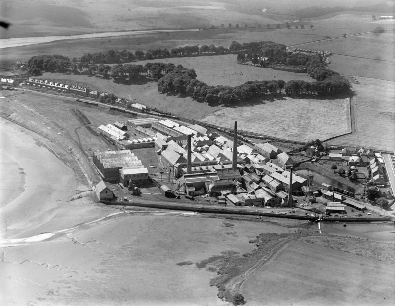 William Haig and Sons Guardbridge Paper Co. Paper Mill, Main Street, Guardbridge.  Oblique aerial photograph taken facing south-west.