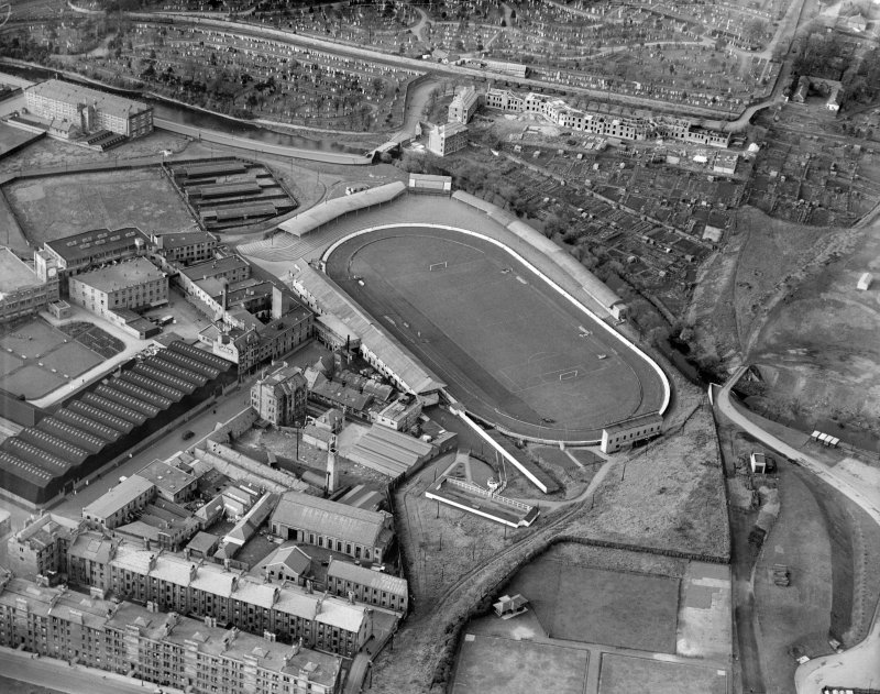 Powderhall Stadium, Powderhall Road, Beaverbank, Edinburgh.  Oblique aerial photograph taken facing west.