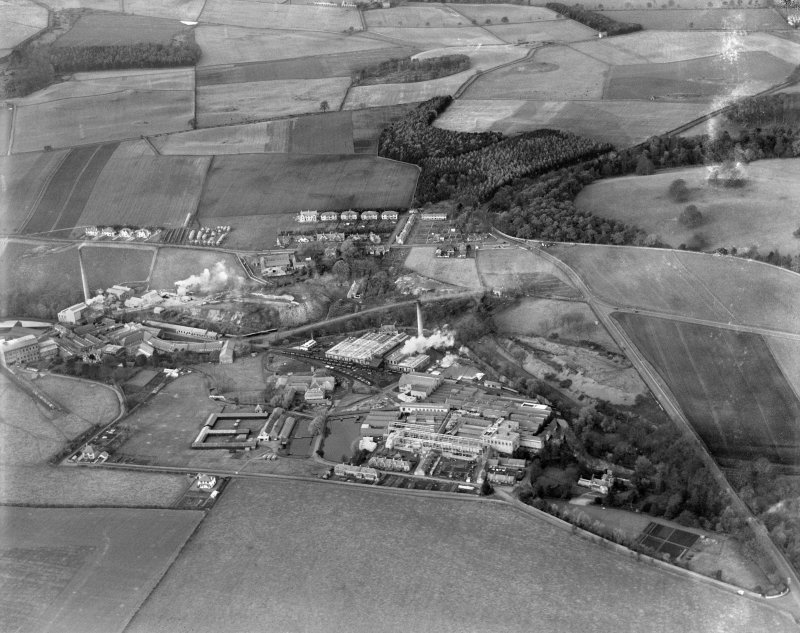 Tullis Russell and Co. Paper Mill, Glenrothes.  Oblique aerial photograph taken facing north. Auchmuty Mill, left, Rothes Bleachfield ('E' shaped building with range to east) bottom, Power Station top ...