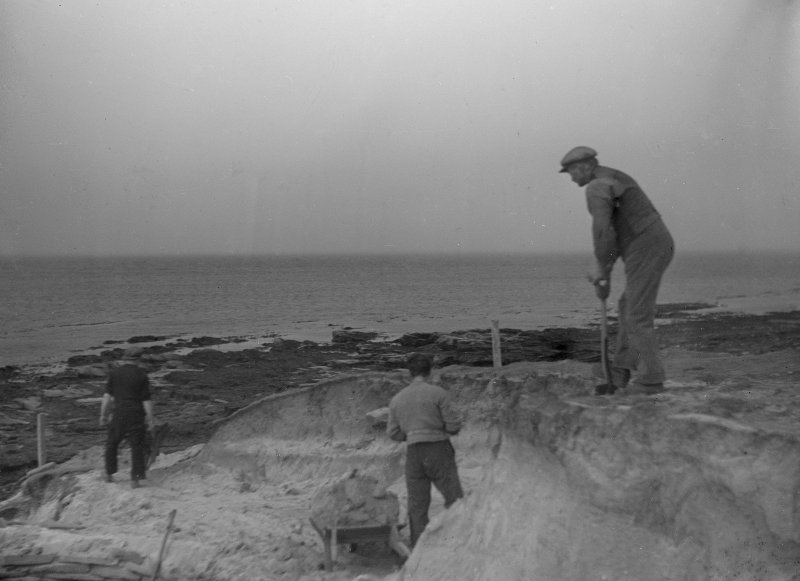 Excavation photograph: Workmen removing blown sand covering house 2.