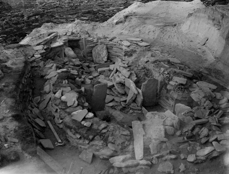 View of house 2 in partially cleared state during excavations of Knap of Howar settlement, Papa Westray, in 1929.