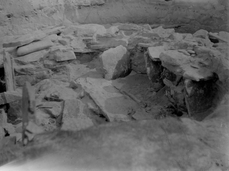 Excavation photograph: House 2, E. end partially cleared.
