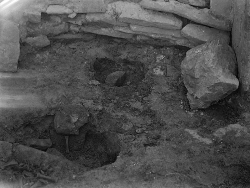 Excavation photograph: House 2, pits in floor at S. E. end.