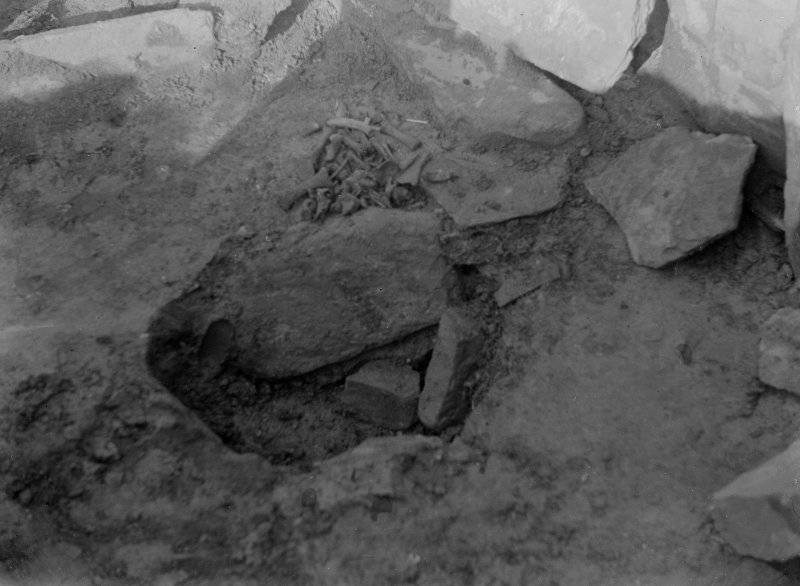Excavation photograph: House 2, Pits in floor at E. end.